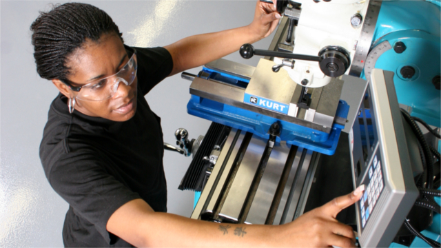 Apprentice working on an industrial machine