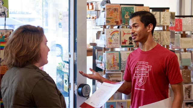 Two people discussing the Mountain View Working Scholars Program.