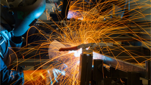 Person welding and sparks flying