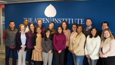 All the Job Quality Fellows standing in front of the Aspen Institute logo