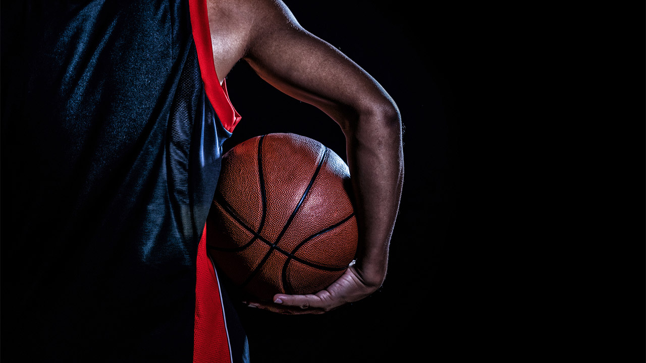 The History Behind the Debate Over Paying NCAA Athletes