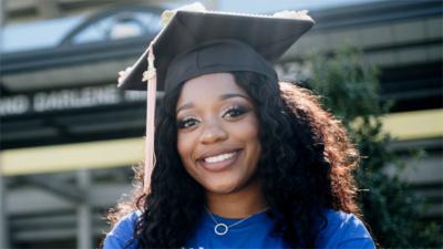 Woman in graduation cap.