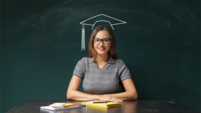 Young woman with graduation hat