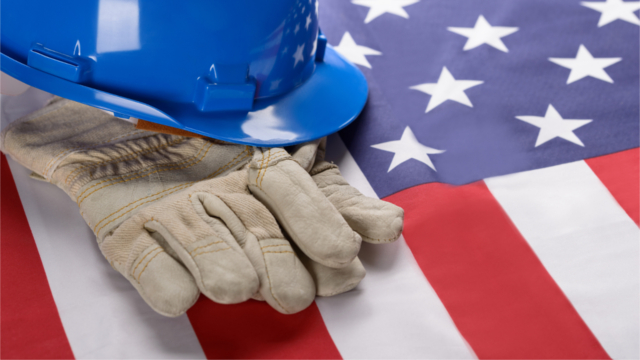Construction hat and gloves resting on an American flag