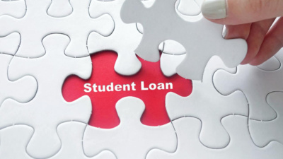 "Puzzle with missing piece that says ""Student Loans"""