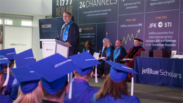 JetBlue's Chief Executive Officer and President, Robin Hayes congratulates the first graduates of JetBlue's employer-sponsored college degree program - JetBlue Scholars. (Photo: Business Wire)