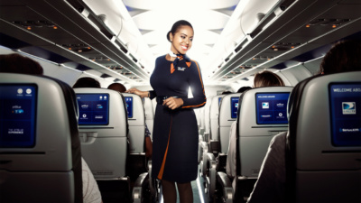 Smiling JetBlue crewmember in airplane