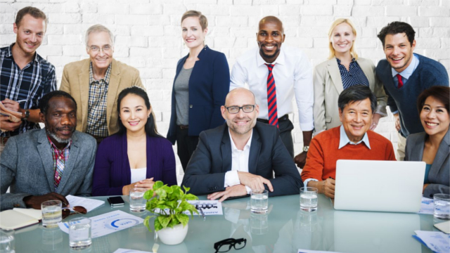 Group of employees sitting at a conference table