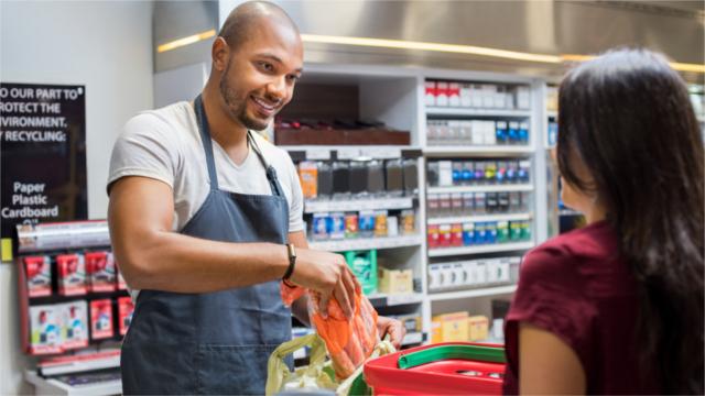 Cashier working at supermarket