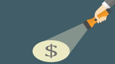 Flashlight shining on dollar sign
