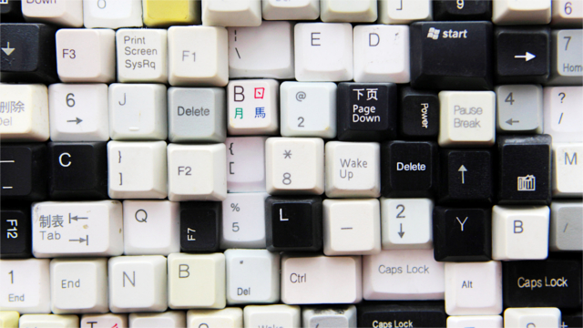 Random assortment of keys from multiple keyboards. Photograph by Bob/Getty Images.