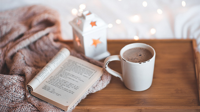 open book with hot chocolate