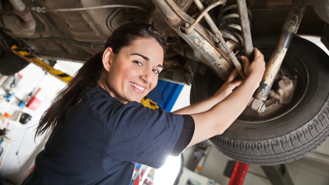 Automotive apprentice working on a car
