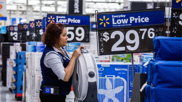 Walmart employee setting up a store display. (Photo: Timothy Fadek/Bloomberg News)