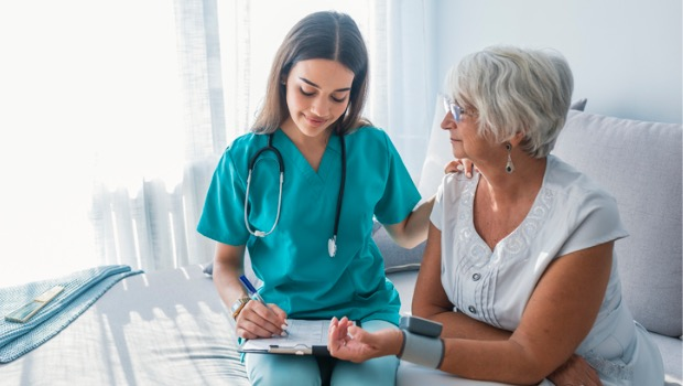 Nurse measuring the blood pressure of a patient.