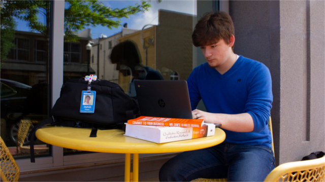 High school student working on laptop
