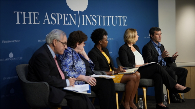 Panelists speak at