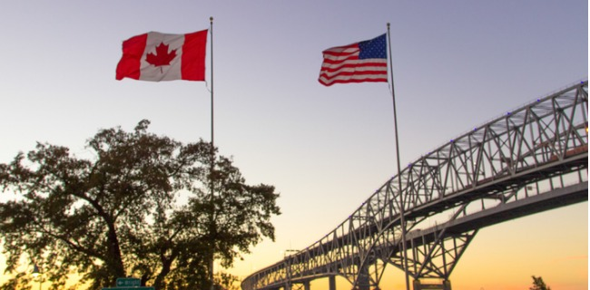 The Cnadian and American flags flying at the International Blue Water Bridge Crossing.