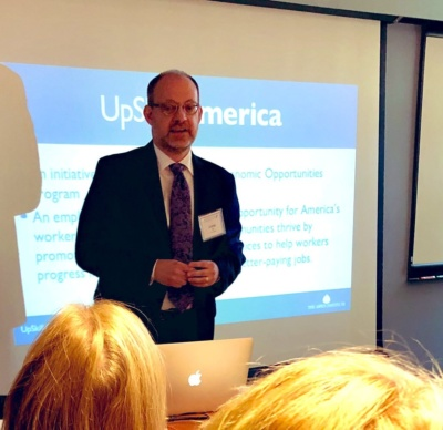 "UpSkill America Director Jaime Fall speaks at a New England Board of Higher Education meeting on ""Upskilling New England: Bridging the Gap between Higher Education and Employers."""