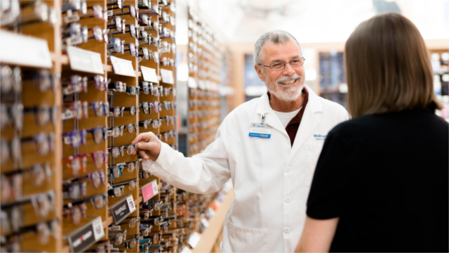 Pharmacy associate assisting customer