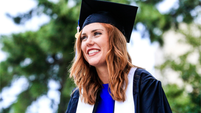 Smiling woman in graduation cap and gown. Photo by Chichi Onyekanne on Unsplash.