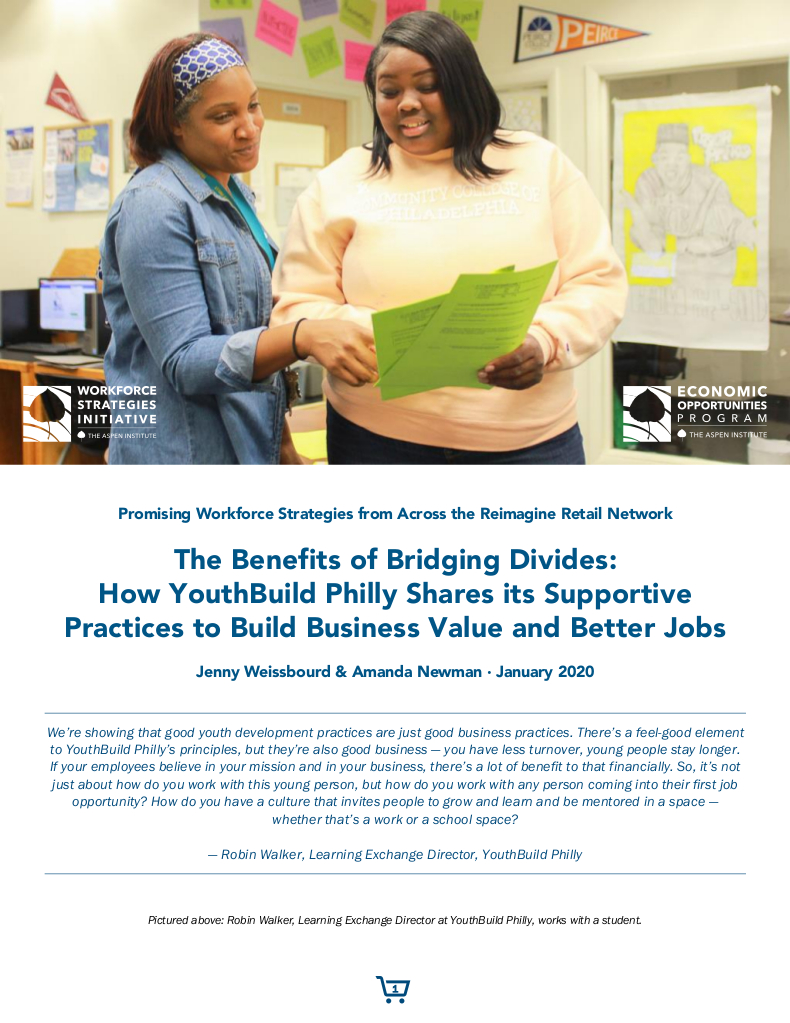 Robin Walker, Learning Exchange Director at YouthBuild Philly, works with a student.