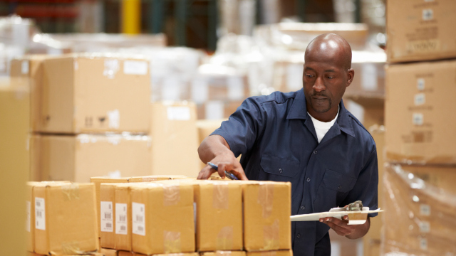 Photo of warehouse worker preparing goods for dispatch
