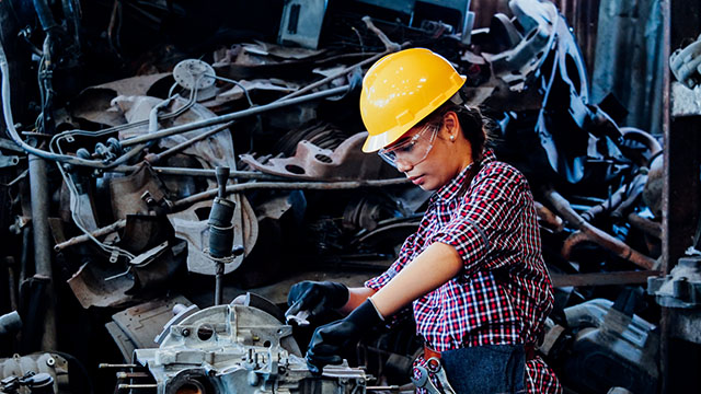 Woman working with machinery