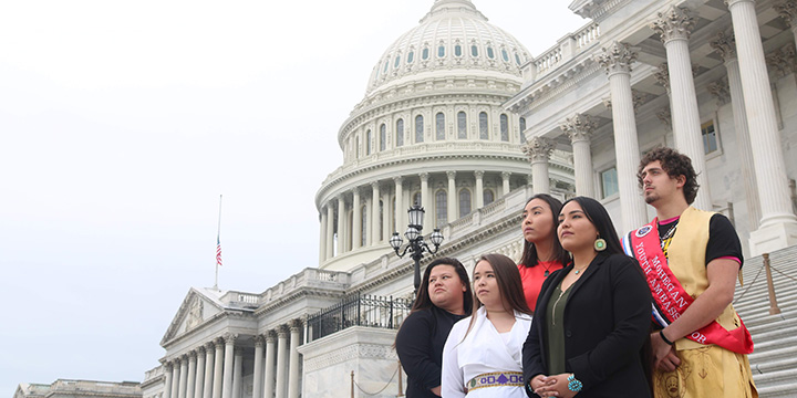 Indigenous youth on the steps of the Capitol