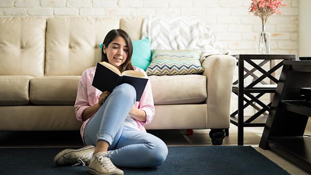 Latina girl reading a book
