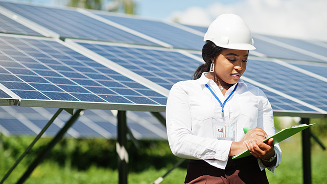 Black solar panel technician