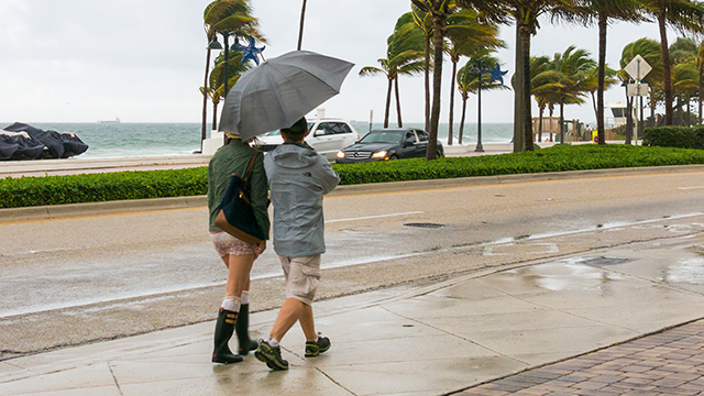 People walking in tropical storm