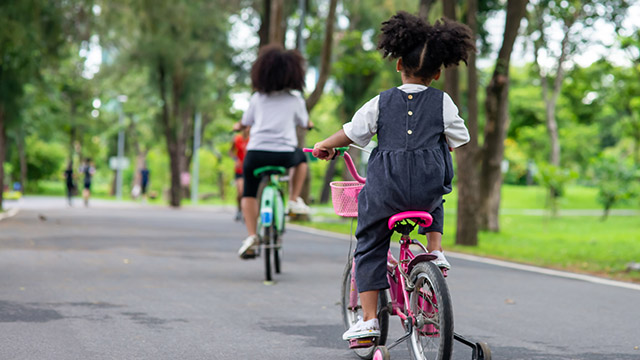Children riding bikes in park