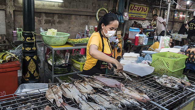 Thai market vendor wearing mask