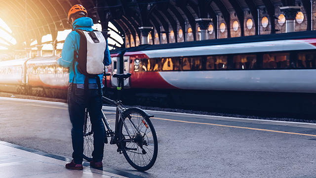 Man with bike waiting for train