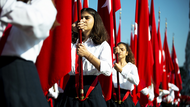 Young women holding Turkish flags