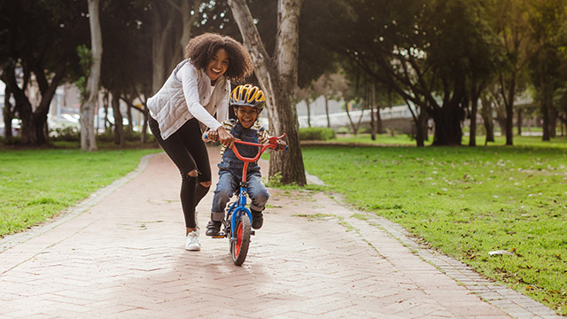 Mom and kid on a bicycle