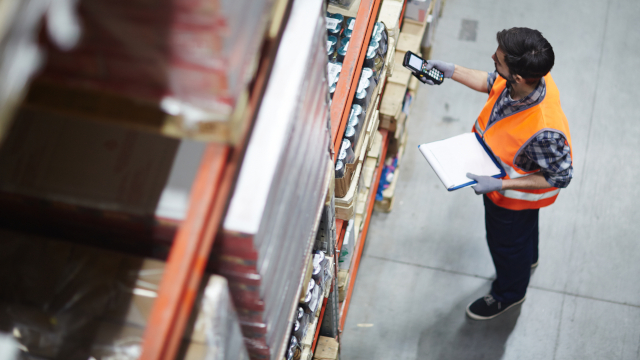 Photo of a worker scanning goods in a warehouse