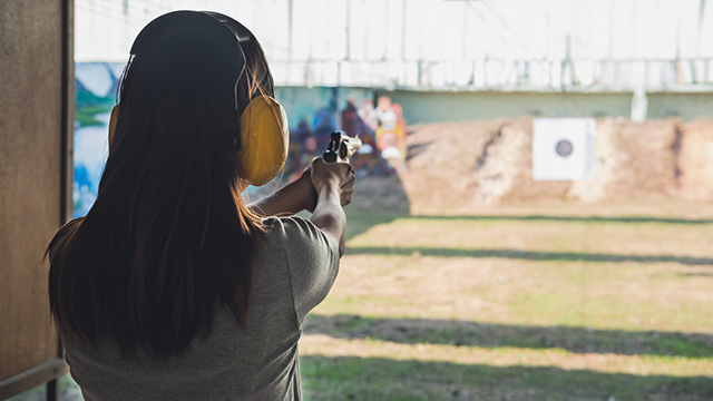Woman practices shooting target